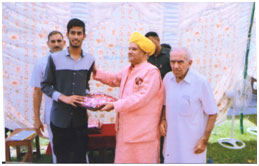 Chief Guest awarding Sh. Sanjay Rathore for securing 19th position in J&K BOSE 10th class 2016